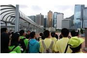 The tour guide was explaining to the participants the background of Hong Kong's financial hub.