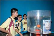 Students were visiting the science museum in Macau and were observing the exhibits.