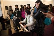 Students were playing instruments at exhibition Hall.