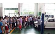 Students were seeing different sedans in the car factory.
