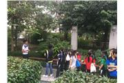 Students listened carefully to the tour-guide's explanation of the operation of Chinese Herbal Garden.