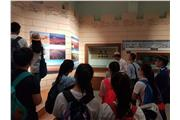 Students listened carefully to the tour-guide's explanation of the  Yangguan Historic Sites