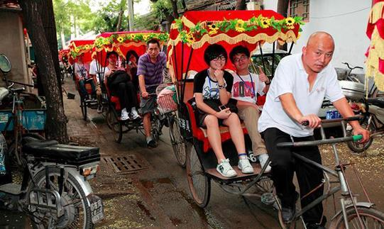 Participants were riding on traditional Chinese rickshaw.