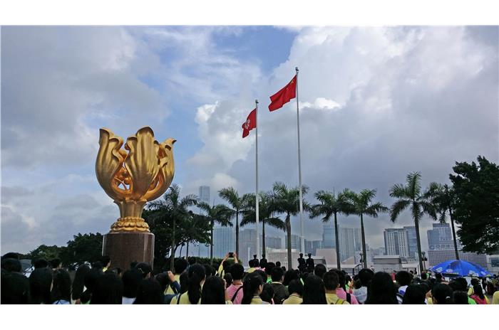Students from Mainland, Macau and Hong Kong were attending the flag raising ceremony at the Golden Bauhinia Square.